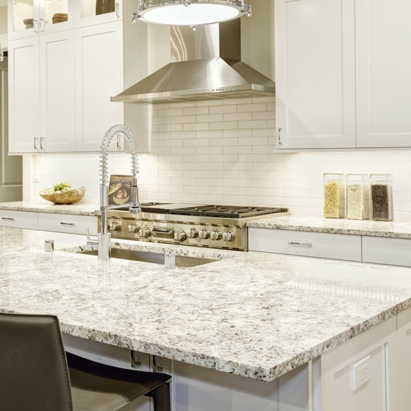 which store to purchase granite countertops that go with white cabinets near me